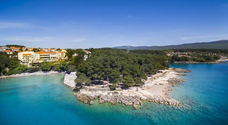 Valamar Koralj Hotel Krk Valamar Koralj Hotel is situated above a bay of the Adriatic Sea on Krk Island, a 10-minute walk from Krk town. It features an outdoor pool with a hot tub and a wellness centre.  The Blue Flag beach is equipped with changing cabins and showers.