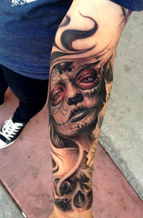 Wispy skull and Santa Muerte tattoo. Click for more Drop Dead Gorgeous Santa Muerte Tattoos.