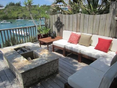 Bermuda - Wood Deck Fire Pit and Lounge Area overlooking the water.