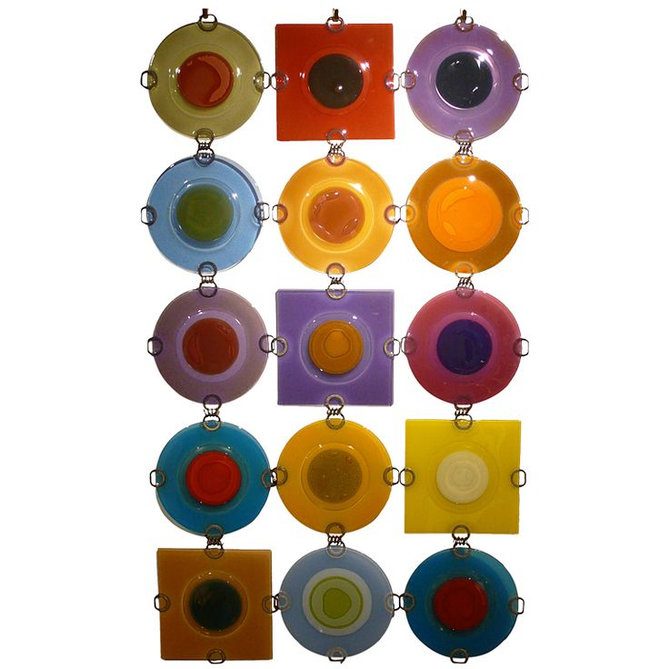 """Vintage 6-Inch Higgins Rondelays United States 1990's Linked grouping of fifteen rondelays by Frances and Michael Higgins. Includes eleven 6-inch round and four 6-inhttp://adminv2.1stdibs.com/archivesE/upload/8285/04_13/l1220146/L1220146_l.jpg?1359232495155ch square rondelays forming a wall mounted composition (18"""" x 30"""") that can be altered to suit.Various color schemes ranging from blue and purple to orange to yellow to green to brown. Purchased directly from the Higginses by the original…"""