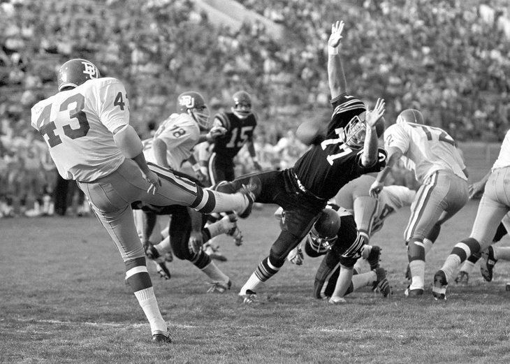 Lon Woodard of San Diego State blocks a punt by Boston University in the Pasadena Bowl (1969) #Archive #Archives #Libraries #SpecialCollections #DigitalCollections #SanDiegoStateUniversity #College #University
