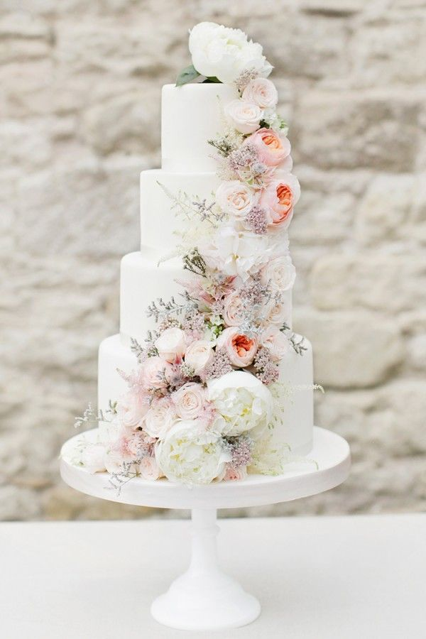 How To Use Pretty Petals Throughout Your Spring Wedding, White wedding cake with spring florals