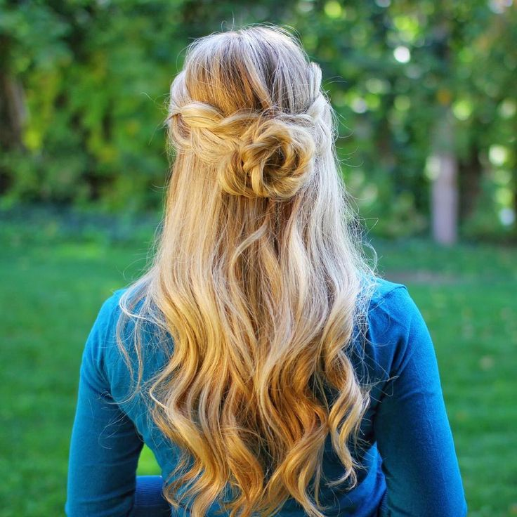 half up half down braided rosette prom hair prom