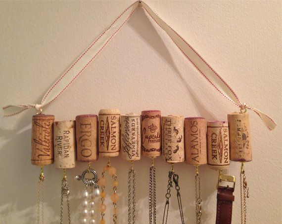 Wine Cork Necklace Rack Adorable way to hang jewelry, this rack made from wine corks comes with an adjustable ribbon perfect for hanging on a wall at any height. Lightweight and sturdy, this rack is equipped with ten hooks and can hold multiple pieces on each.  I think a medium sized bead between each cork might look interesting....