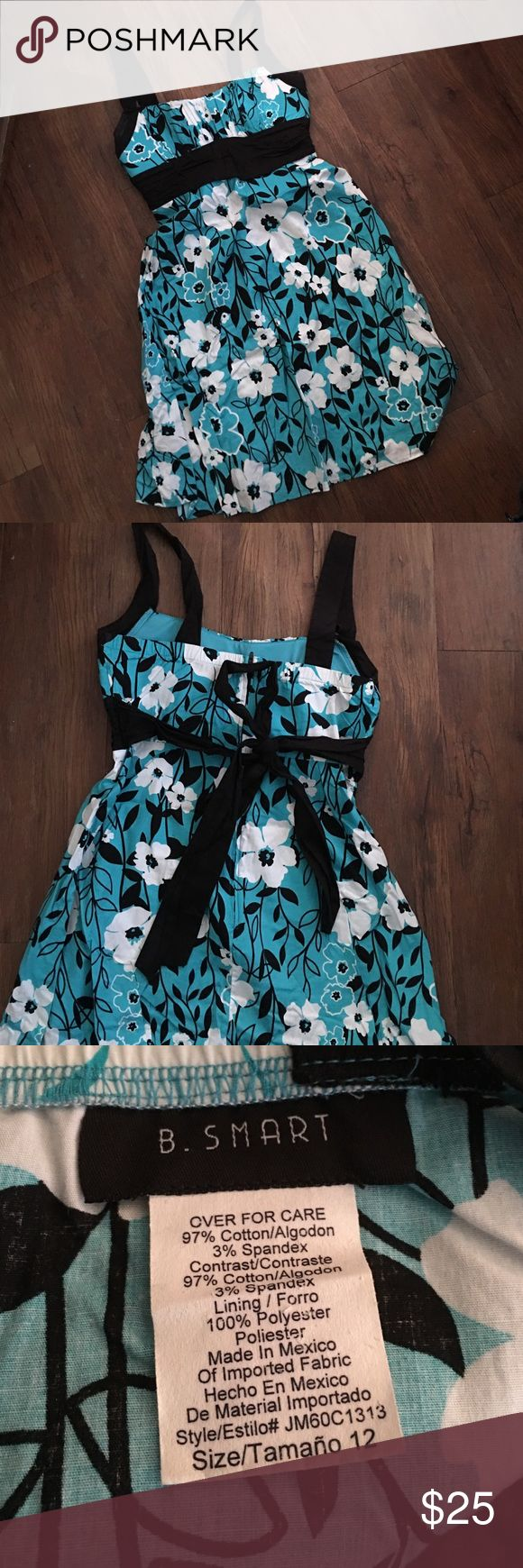 Gorgeous blue dress Gorgeous blue dress with white and black details. Zips up back and sash ties. Only worn once to a wedding however there is a couple loose threads on right side by strap as shown in picture. Make me an offer b.smart Dresses Asymmetrical