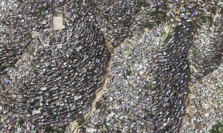 Hill-side slum: Slum-dwelling residents of Port-au-Prince, Haiti, face bleak living conditions in the western hemisphere's poorest country Photograph: Google Earth/2014 Digital Globe