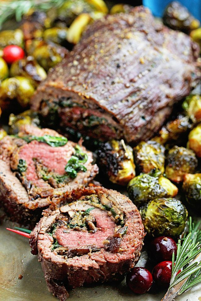 Stuffed Flank Steak Recipe with Roasted Brussel Sprouts Recipe – This steak is stuffed with mushrooms, spinach, garlic and herbs and roasted to perfection. The Roasted Brussel Sprouts are simply drizz