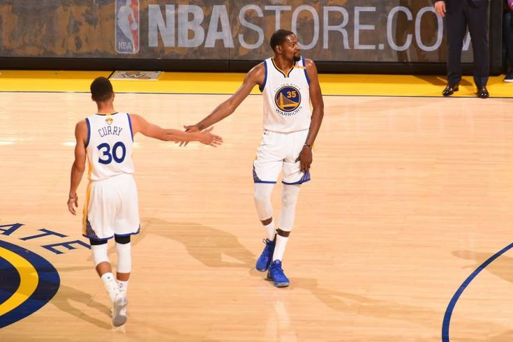 OAKLAND, CA - JUNE 12:  Stephen Curry #30 and Kevin Durant #35 of the Golden State Warriors shakes hands in Game Five of the 2017 NBA Finals against the Cleveland Cavaliers on June 12, 2017 at Oracle Arena in Oakland, California. NOTE TO USER: User expressly acknowledges and agrees that, by downloading and or using this photograph, user is consenting to the terms and conditions of Getty Images License Agreement. Mandatory Copyright Notice: Copyright 2017 NBAE (Photo by Noah Graham/NBAE via…