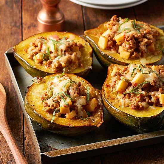 Roasted Acorn Squash with Apple-y Sausage: Cheddar, sausage and apple make a sweet-and-savory filling for acorn squash in this satisfying main dish. (Bonus: It's pretty enough to serve guests for a cozy Sunday supper.)