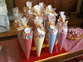 Wrapped popcorn cones as wedding favors.  Guests can pick a cone, fill popcorn…