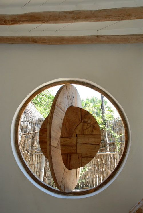 "Love this swing ""window"" shutter.  No glass in this African home.  The shutter keeps critters out at night."