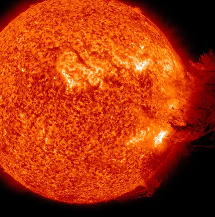 In this handout photo released by Nasa Earth Observatory on June 7, 2011 and taken from Nasa's Solar Dynamics Observatory, sunspot complex 1226-1227, shows the Sun unleashing an M-2 (medium-sized) solar flare, an S1-class radiation storm and a coronal mass ejection resulting in a large cloud of particles mushrooming up and falling back down giving the impression of covering an area of almost half the solar surface. (NASA)