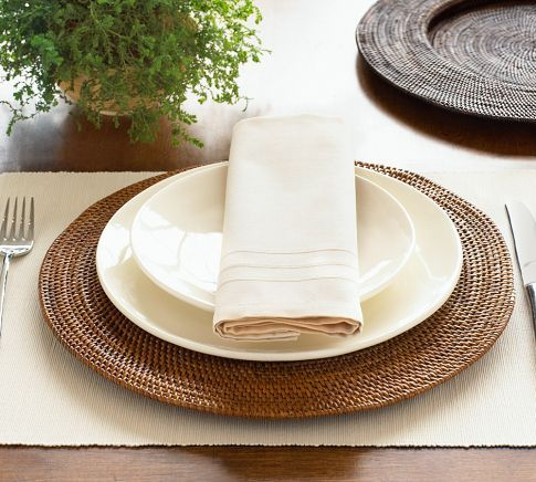 Pottery Barn's Round Tava Charger made from woven natural rattan