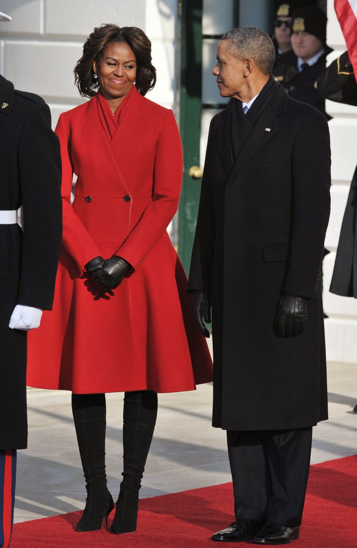 First Lady Michelle Obama and President Barack Obama. She wears a Thom Browne coat and high heel boots to welcome French President Francois Hollande to the White House with her husband. - MarieClaire.com