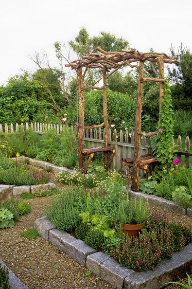 Kitchen Gardens - Design Chic - Love these raised beds & the rustic seat in the middle of it all!
