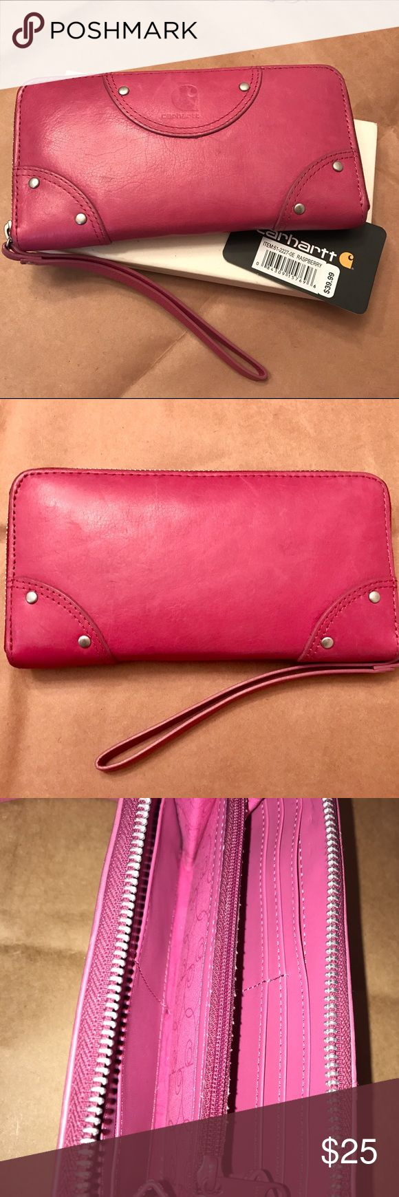 """Carhartt Womens Zippered Clutch - Raspberry Full Grain Napa leather - Eight credit card pockets - Two billfolds with zippered change pocket - Room for checkbook inside zippered outer closure - Wrist strap - Heat stamped Carhart logo on front - Printed fabric lining - 4 1/4 """" x 7 3/4"""". 🔹Carried for about 2 months. Slight marks on exterior - hard to see (pics)  - Full Grain Napa leather - Eight credit card pockets - Two billfolds with zippered change pocket - Silver finished nail heads…"""
