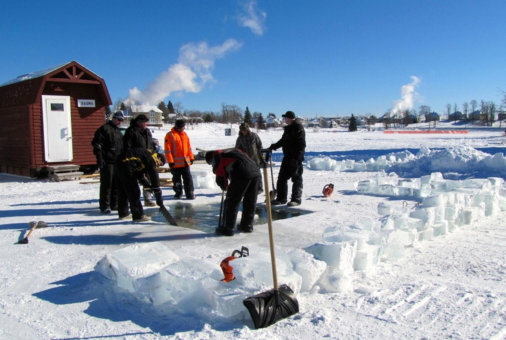 Cutting through 30 inches of ice for the Polar Bear Dip .. Cochrane Ontario Carnival 2013