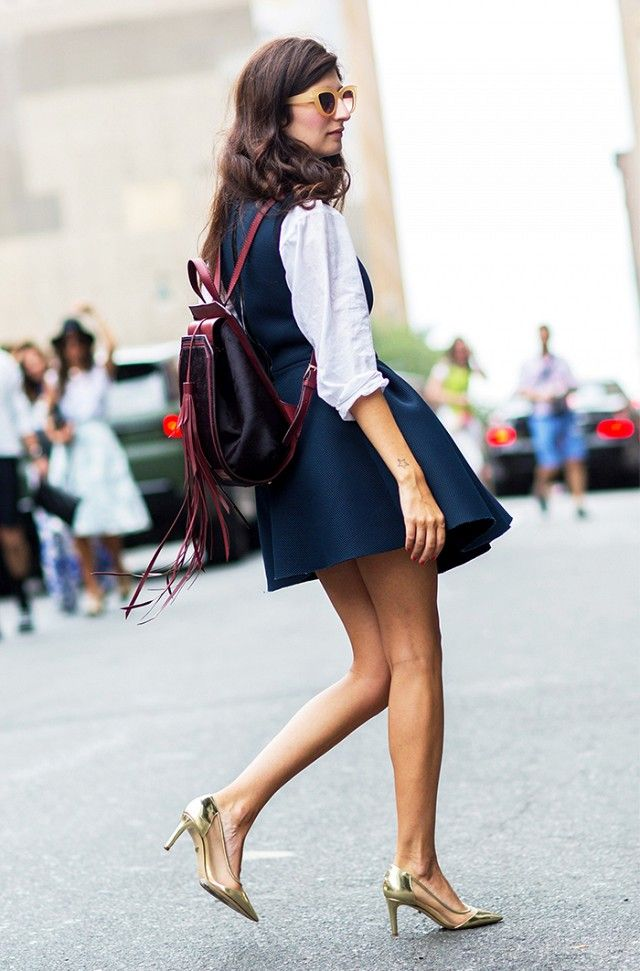 Pair a skater skirt and luxe backpack with metallic gold heels for a flirty but high-fashion school girl look