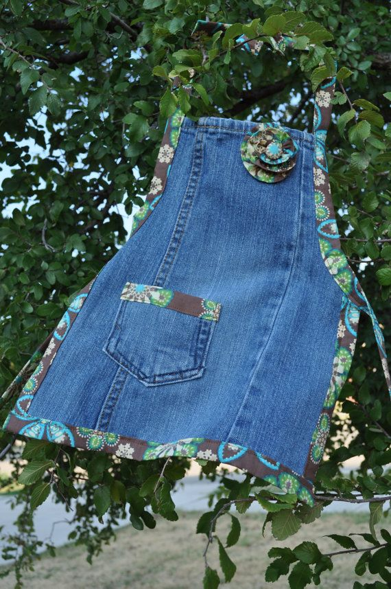 Aprons from jeans.  Great sewing idea.  this was sold on etsy no pattern. - It looks like she just cut open the leg of a pair of jeans, cut it into an apron shape, and edged it in bias tape. The pocket is great. Probably a back pocket removed and placed onto the apron. Fun!