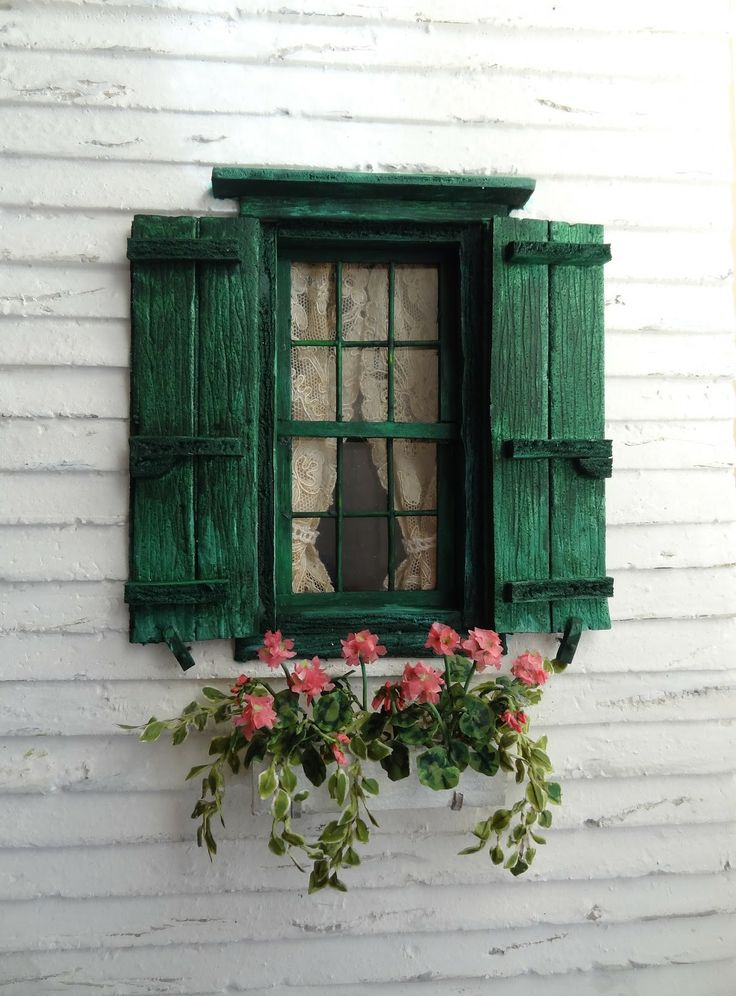 Cute little window, I love the shutters and flower box.