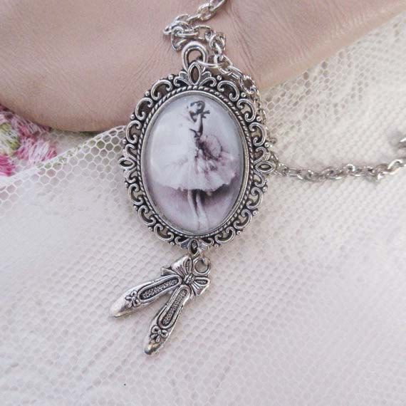 This very feminine ballerina necklace is vintage inspired!  A beautiful image set in an antique silver pendant with a little pair of antique
