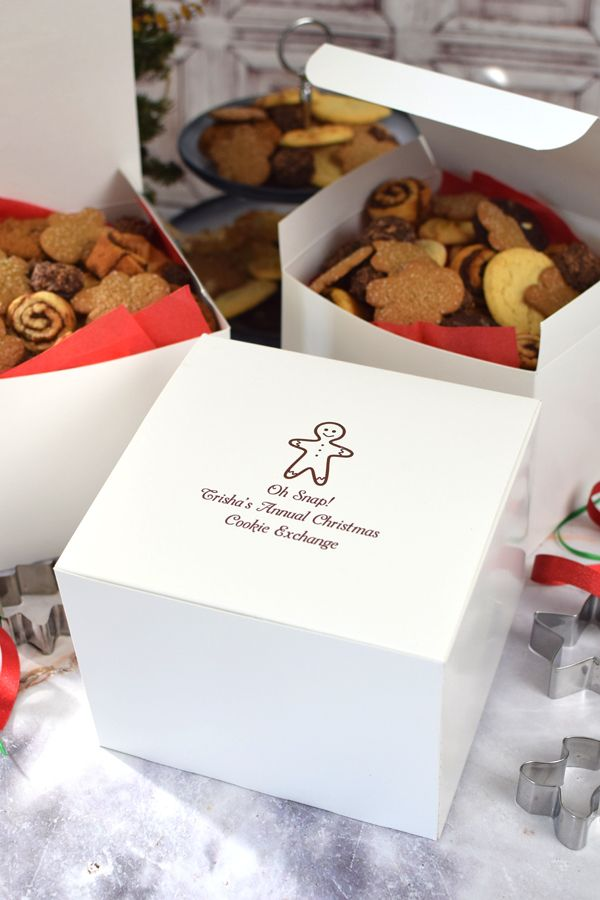 Oh snap. We've found the perfect Christmas cookie exchange boxes guaranteed to get your friends talking. Great for both holiday cookie exchanges and for packaging hostess gifts, these custom printed white Christmas gift boxes will put a smile on any face personalized with your own custom thank you message.  These versatile boxes can be filled with cookies at your cookie exchange or used for your holiday gifts. Insert a coffee mug with hot chocolate mix, a hat and mittens, and other gifts.