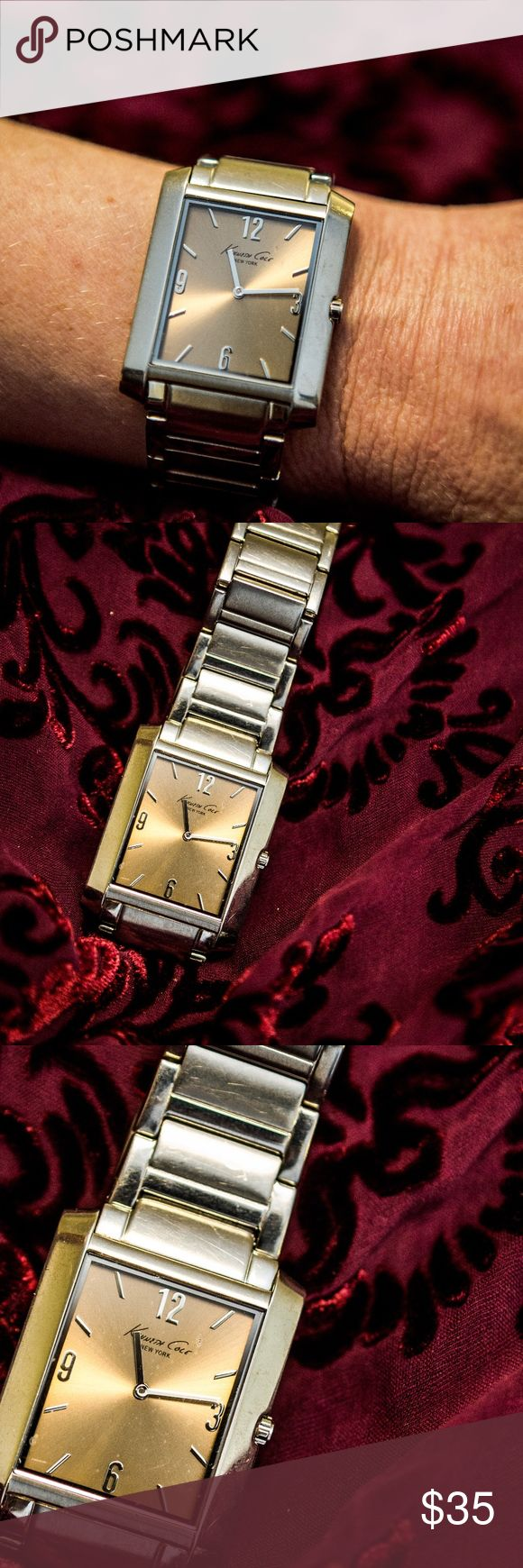 KENNETH COLE   l   WOMEN'S SILVER WATCH Bigger is better! This beautiful silver tone Kenneth Cole watch for women is a show stopper. The face is in gold tone with silver numbers/symbols. Sized for a smaller wrist. Kenneth Cole Accessories Watches