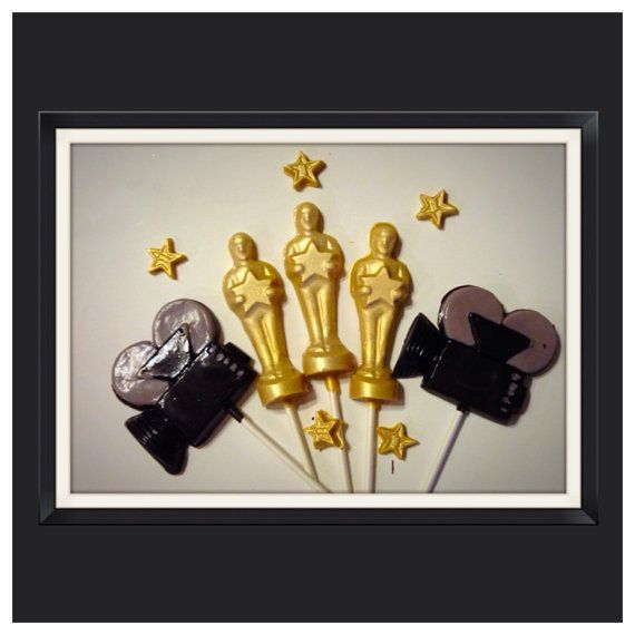 Set of 6 Oscar Themed Chocolate lollipops and 6 video camera lollipops The perfect addition to your Oscar themed party! This shimmering lollipop is