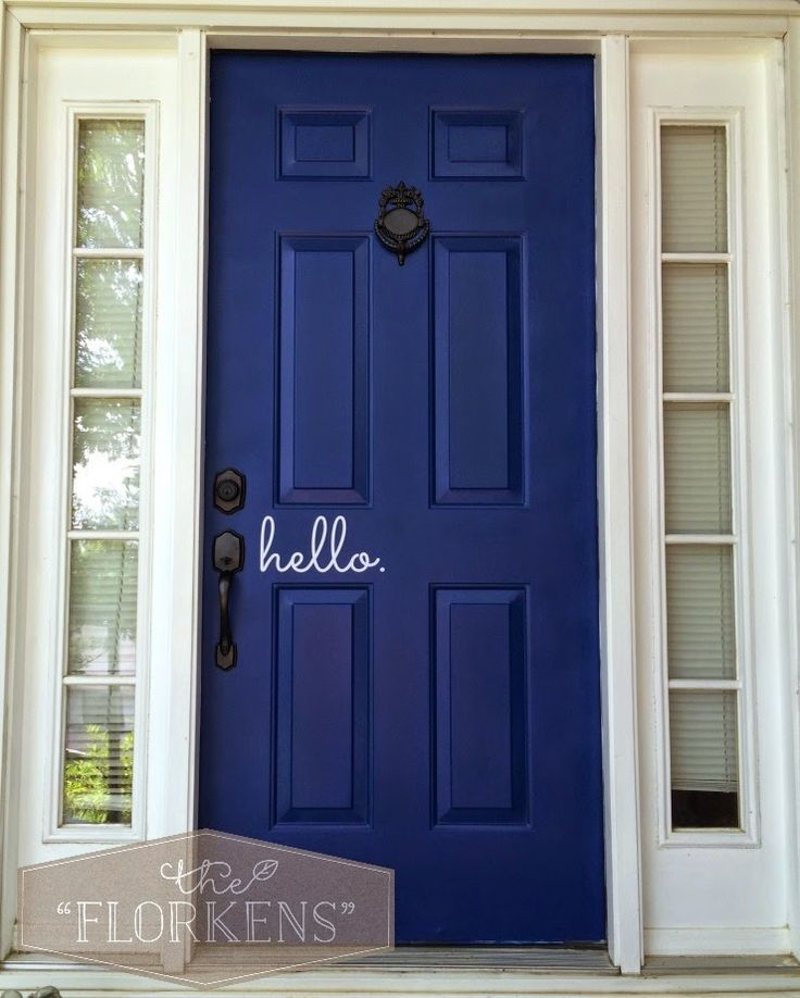 """Gorgeous blue door. Love the sweet """"hello"""" decal - so welcoming! 