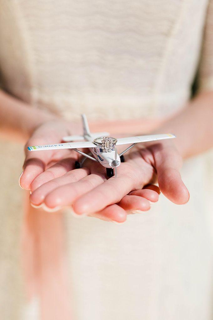 vintage airplane engagement session | Leah Barry Photography | Glamour & Grace | unique engagement ring | emerald cut Diamond