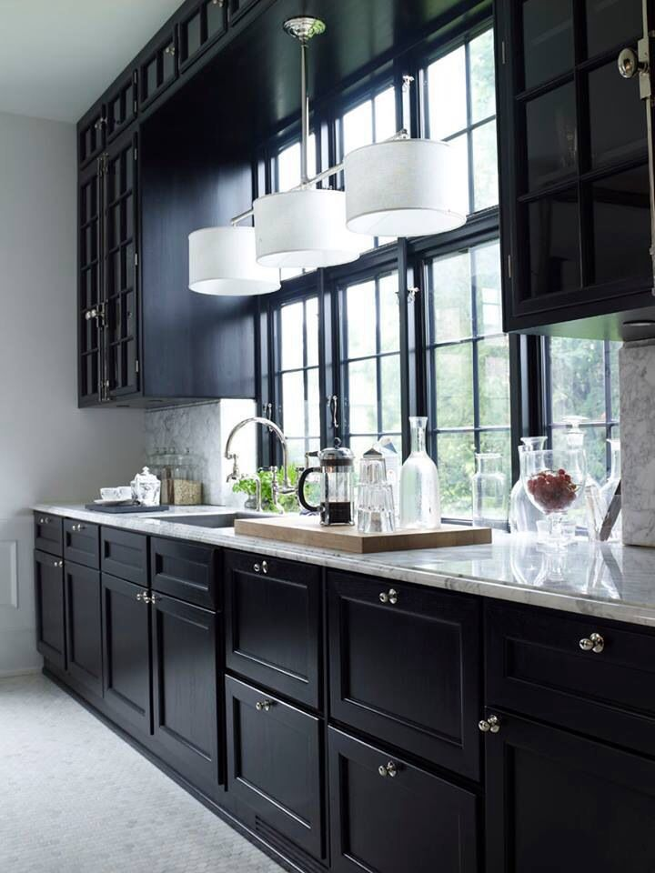 Classic marble and black.... kinda liken the dark cabinets and window trim. Love the island chandelier over the sink.