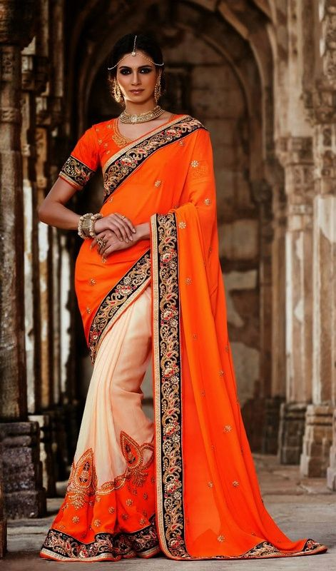 Accentuate your beautiful self dressing in this orange and beige georgette half n half saree. You could see some intriguing patterns carried out with cord, resham and stones work. #DesignerSareeCollection