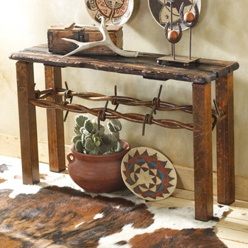 barbed wire table.  Perfect for that vacation house we will have someday in Central Oregon or Montana :)