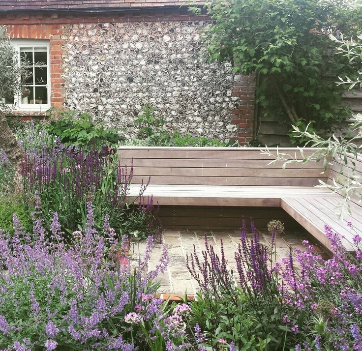 Built in hardwood seating. Designed and built by Mike harvey gardens