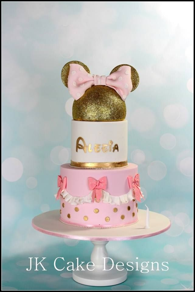 Pink and Gold Minnie Mouse first birthday party cake idea. For more ideas, visit A Pop of Party!
