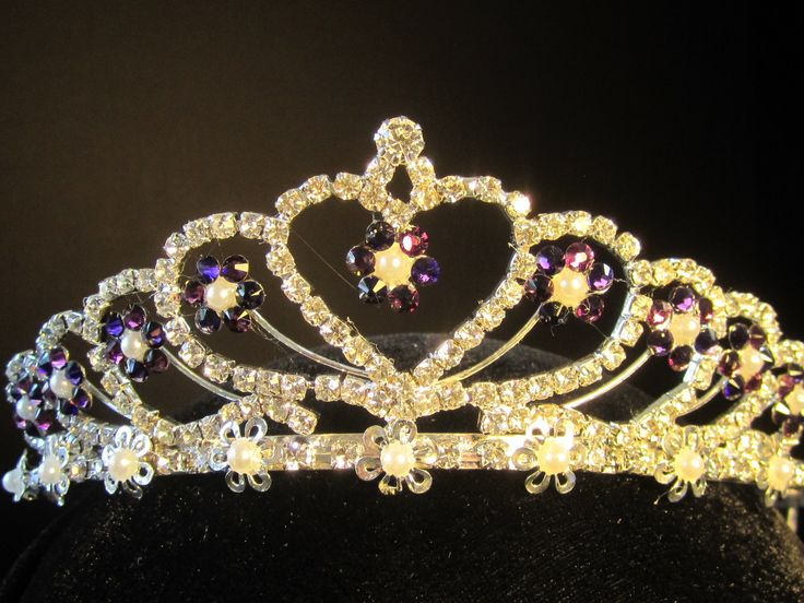 Rhinestone  heart  tiara  with  small  pearls  hand  decorated  with  Swarovski  royal  purple  &  ameythst   crystals  - $31.95 For  more  info  please  contact - Shoot   for  the  Moon  Jewelry  Designs (850) 230-9983 #bridaltiaras #Tiaras #rhinestones