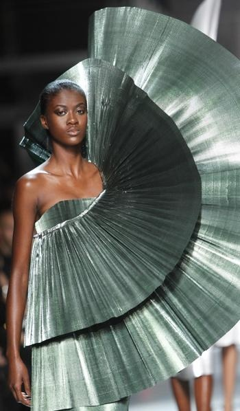 A model wears a creation by Indian fashion designer Manish Arora for Paco Rabanne's spring-summer 2012 ready-to-wear collection in Paris.