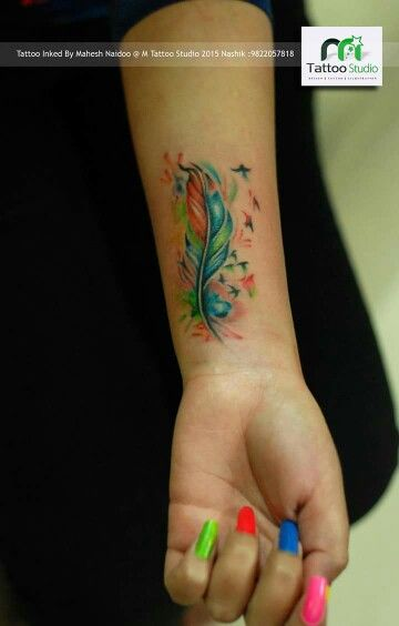 Color feather tattoo