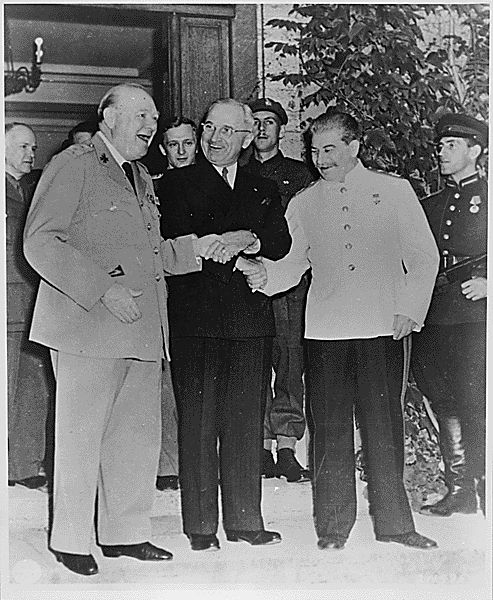 Triple handshake between Winston Churchill, Harry Truman and Joseph Stalin, Germany, 1945