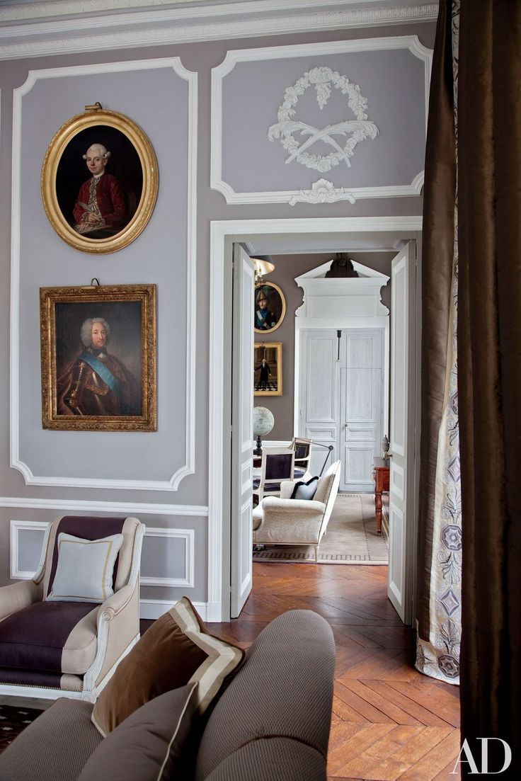 Beneath two antique portraits in a Paris living room renovated by interior  designer Jean Louis Best 25 rooms ideas on Pinterest High ceiling