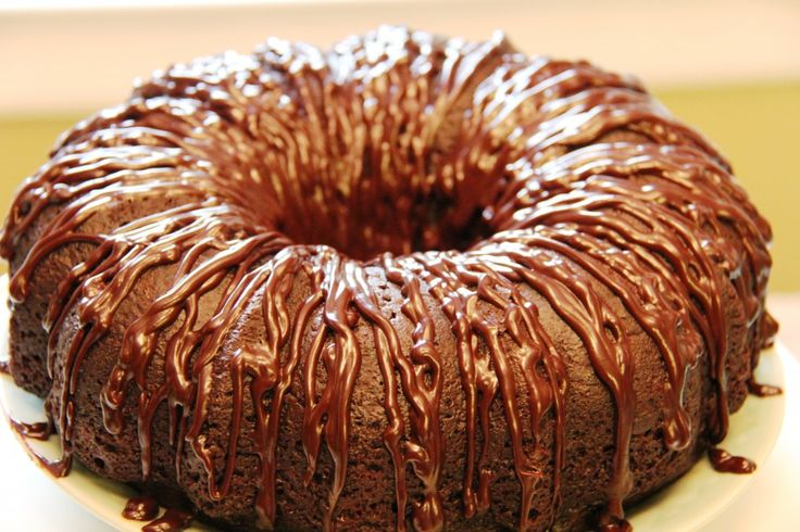 Nearly 60K Pins! Our Triple Chocolate Kahlua Cake is an easy doctored cake mix loaded with chocolate and soaked with a buttery Kahlua glaze. | Sumptuous Living | http://sumptuousliving.net/mandys-triple-chocolate-kahlua-cake/