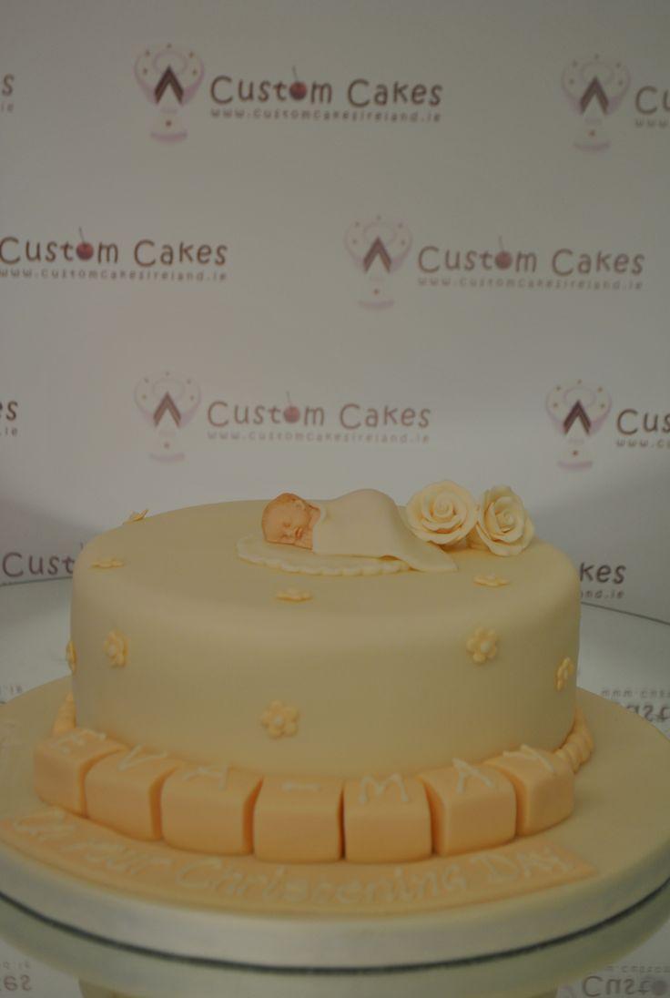 Orange coloured christening cake.