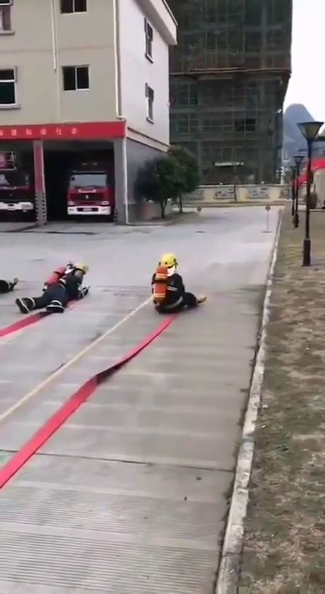 Teaching kids how to handle fire hoses. Watch as the one of the left starts to take off.