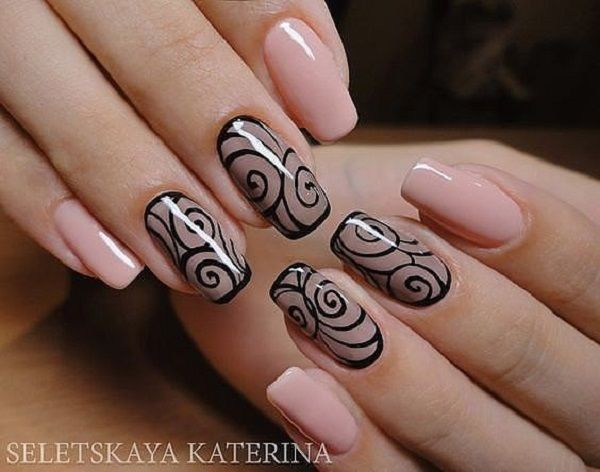 Nude colored winter nail art design. The nails are painted with a nude base color and on top are this black curved lines are added for effect.