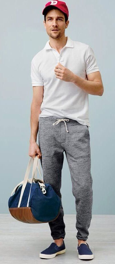 Opt for comfort in a white polo and grey running pants. Take a classic approach with the footwear and opt for a pair of navy canvas slip-on sneakers.   Shop this look on Lookastic: https://lookastic.com/men/looks/polo-sweatpants-slip-on-sneakers/14436   — Red Baseball Cap  — White Polo  — Grey Sweatpants  — Navy Canvas Duffle Bag  — Navy Canvas Slip-on Sneakers