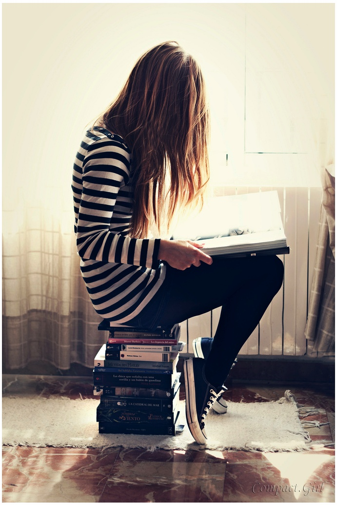 love the colors and the idea of sitting on books... I'd definitely do something to see the face though