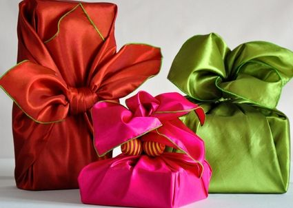 Love these gifts wrapped in scarves via A Gift Wrapped Life.