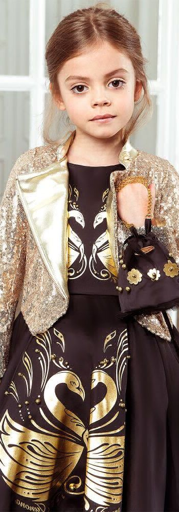 SALE !!! JUNONA Girls Gold Sequinned Jacket & Black Swan Dress. Gorgeous Special Occasion Look for Girls. Perfect for a Family Event or Holiday Party. Heads will turn when your Little Princess enters the room wearing this amazing sequinned jacket. Looks perfect with this elegant Junona Black Swan Dress. Now on Sale! #kidsfashion #fashionkids #girlsdresses #childrensclothing #girlsclothes #girlsclothing #girlsfashion #cute #girl #kids #fashion