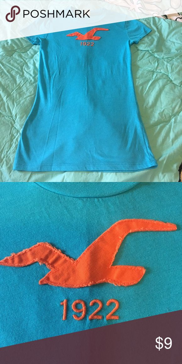 Women's XS Hollister Tshirt. Like New! Like new Hollister cap sleeve XS turquoise with orange stitched logo. Don't think this was ever worn. Great for everyday summer wardrobe Hollister Tops Tees - Short Sleeve