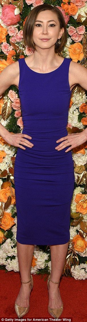 Dressed to the nines: Kimiko Glenn chose a skintight sleeveless blue dress that showed off...